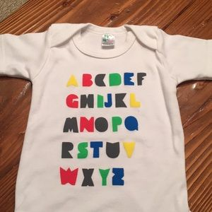 Short sleeved onesie with alphabet on front
